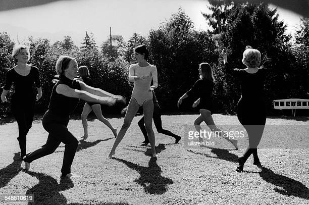 women at gymnastics exercises on a meadow 1971 Photographer Jochen Blume Vintage property of ullstein bild