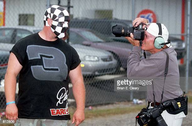 Sports Illustrated photographer George Tiedemann photographs an enthusiastic Dale Earnhardt fan at the Southern 500 NASCAR race in Darlington SC...