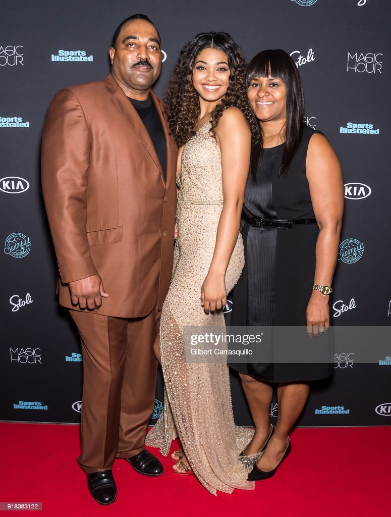 Sports Illustrated Swimsuit cover model Danielle Herrington (center) poses with her parents Darryl Herrington and Theresa Herrington during the 2018 Sports Illustrated Swimsuit Issue Launch Celebration at Magic Hour at Moxy Times Square on February 14, 2018 in New York City.