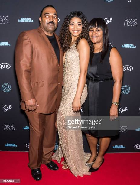 Sports Illustrated Swimsuit cover model Danielle Herrington poses with her parents Darryl Herrington and Theresa Herrington during the 2018 Sports...