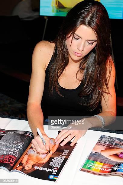 Sports Illustrated swimsuit model Zoe Duchesne signs Sports Illustrated magazines for fans at the Paris Las Vegas on February 11 2010 in Las Vegas...