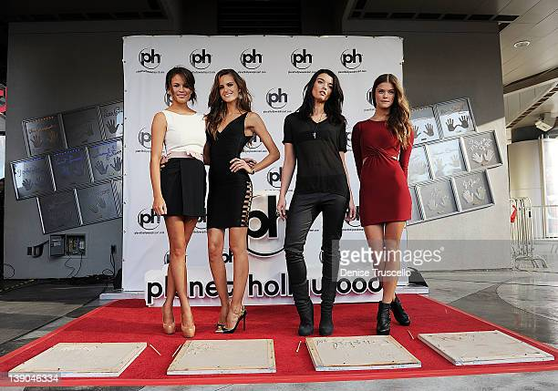 Sports Illustrated swimsuit models Chrissy Teigen Izabel Goulart Crystal Renn and Nina Agdal pose for photos at the handprint ceremony to comemorate...