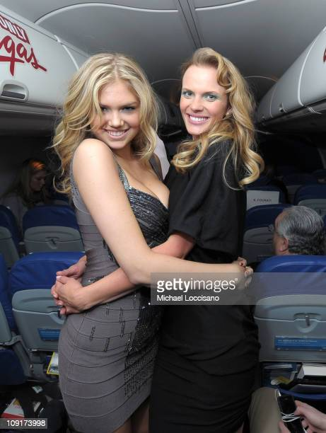 Sports Illustrated swimsuit models Kate Upton and Anne V on board the 2011 SI Swimsuit Models New York To Las Vegas Flight on February 15 2011 in New...