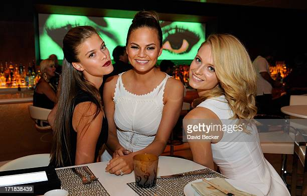 Sports Illustrated swimsuit models Nina Agdal Chrissy Teigen and Kate Bock appear at Andrea's at Encore Las Vegas on June 28 2013 in Las Vegas Nevada