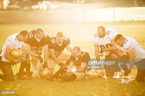 Sports injury at sunset.