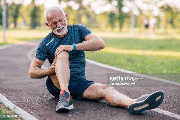 sports injury at the training - patella stock pictures, royalty-free photos & images