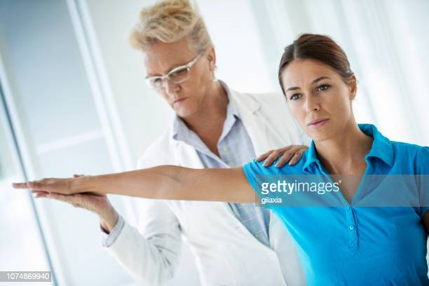 sports injury medical exam. - sports medicine stock pictures, royalty-free photos & images