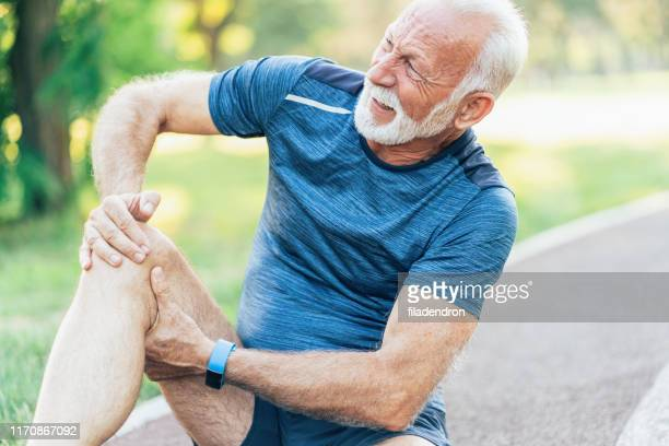 sports injury - down on one knee stock pictures, royalty-free photos & images