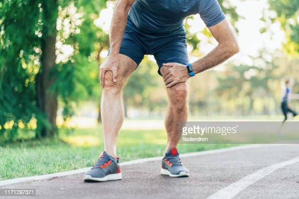 sports injury - arthritis stock pictures, royalty-free photos & images