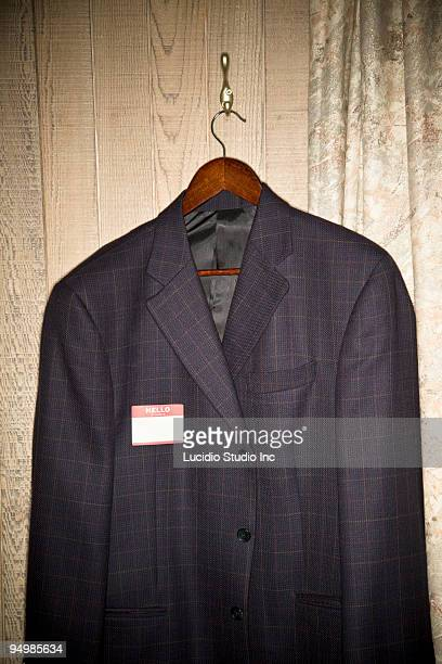 Sports jacket with a 'Hello My Name Is' sticker