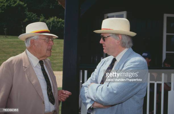 Sports journalist and cricket commentator E W 'Jim' Swanton talking to songwriter Tim Rice at the first match to be played at John Paul Getty Jr's...