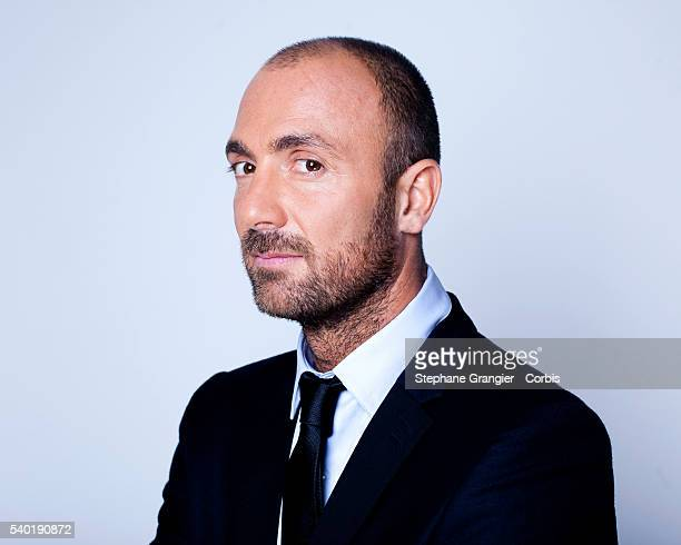 Sports journalist Christophe Dugarry poses during a photo shoot on September 27 2016 in Boulogne Billancourt Paris France