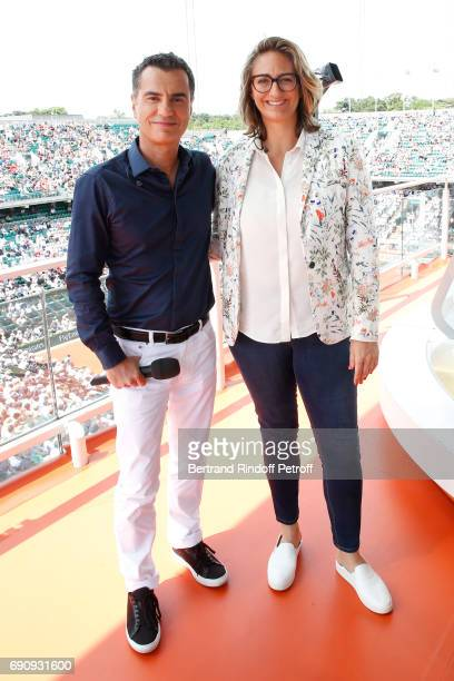 Sports Journalist Laurent Luyat and Consultant of 'France Television', Mary Pierce pose during the 2017 French Tennis Open - Day Four at Roland...
