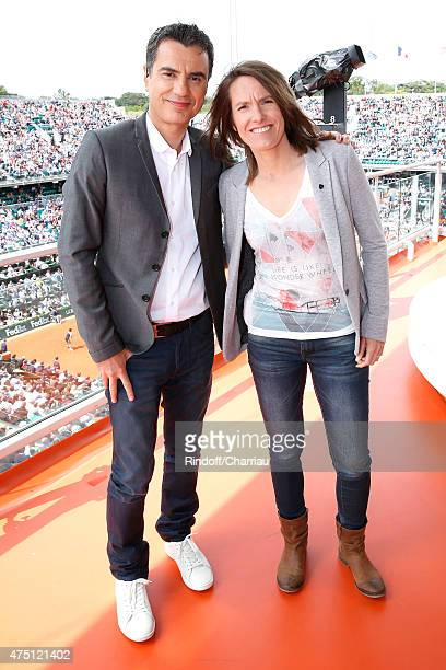 Sports journalist Laurent Luyat and Former Tenis player Justine Henin pose at France Television french chanel studio during the 2015 Roland Garros...