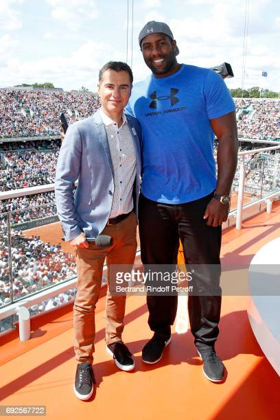 Sports Journalist Laurent Luyat and Judoka Teddy Riner pose at France Television french chanel studio during the 2017 French Tennis Open Day Height...