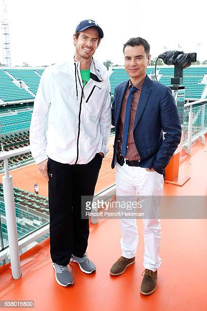 Sports Journalist Laurent Luyat and Tennis Player Andy Murray pose at France Television french chanel studio during Day Fourteen Women single's Final...