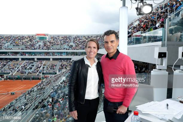 Sports Journalist Laurent Luyat and Tennis player Justine Henin pose at France Television french chanel studio during the 2019 French Tennis Open -...