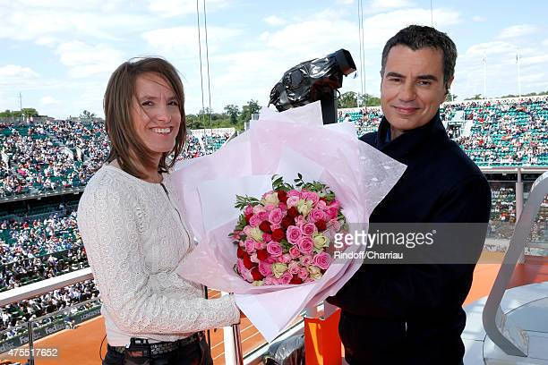 Sports journalist Laurent Luyat gives flowers to Former Tenis player Justine Henin for her 33th birthday at France Television french chanel studio...