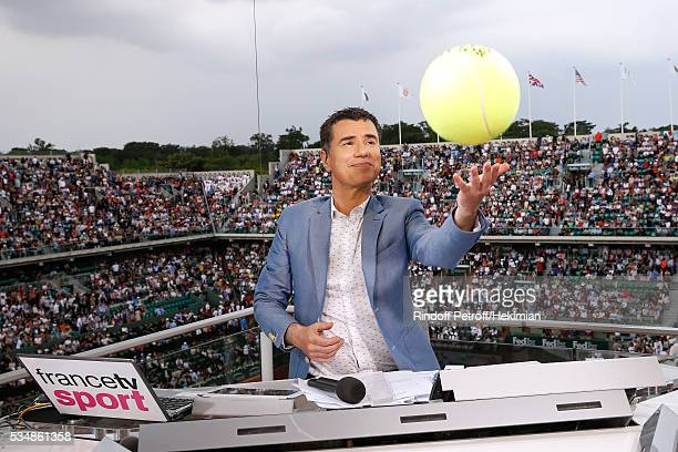 Sports journalist Laurent Luyat plays with a tennis ball at France Television french chanel studio during Day Seven of the 2016 French Tennis Open at...