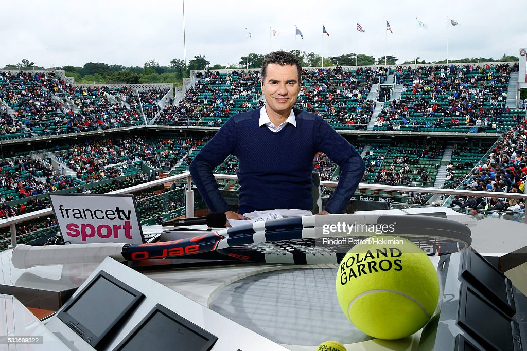 Sports journalist Laurent Luyat poses at France Television french chanel studio during the 2016 French Tennis Open - Day Two at Roland Garros on May 23, 2016 in Paris, France.