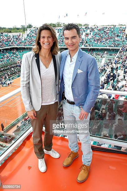 Sports journalist Laurent Luyat poses with his CoPresenter Amelie Mauresmo at France Television french chanel studio during the 2016 French Tennis...