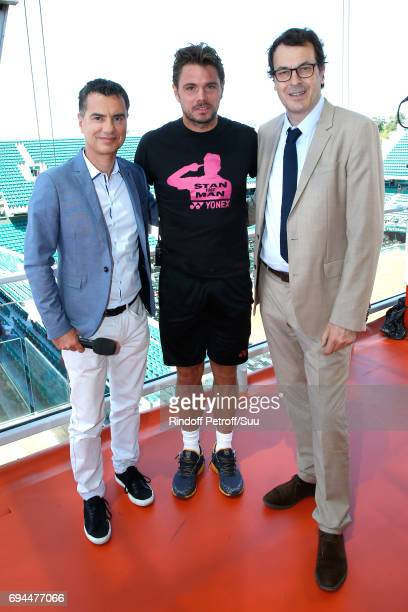 Sports Journalist Laurent Luyat Stanislas Wawrinka aka Stan Wawrinka and Director of Sports at France Television LaurentEric Le Lay pose at France...