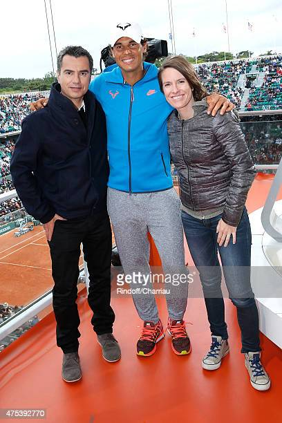 Sports journalist Laurent Luyat, Tennis Player Rafael Nadal and Former Tenis player Justine Henin pose at France Television french chanel studio...