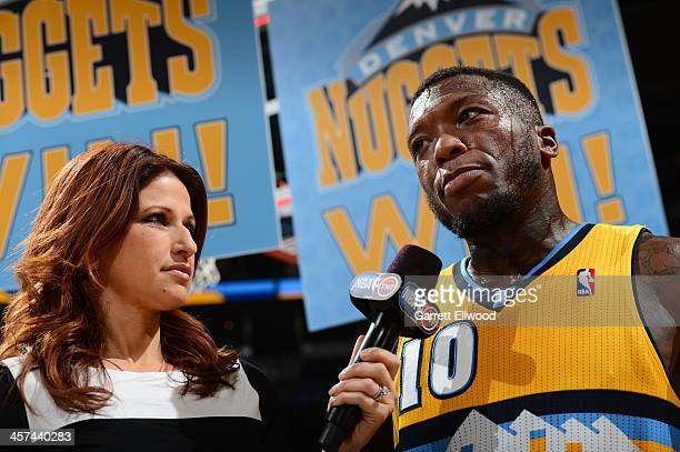 Sports journalist Rachel Nichols interviews Nate Robinson of the Denver Nuggets after the game against the Chicago Bulls on November 21 2013 at the...