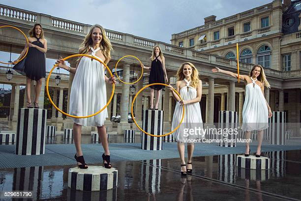 Sports journalists AnneLaure Bonnet Mariella Tiemann Marie Patrux Claire Arnoux and Vanessa Le Moigne are photographed for Paris Match wearing...