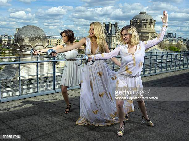 Sports journalists Nathalie Renoux Carine Galli Louise Ekland are photographed for Paris Match wearing clothing by Diane Von Furstenberg on April 14...