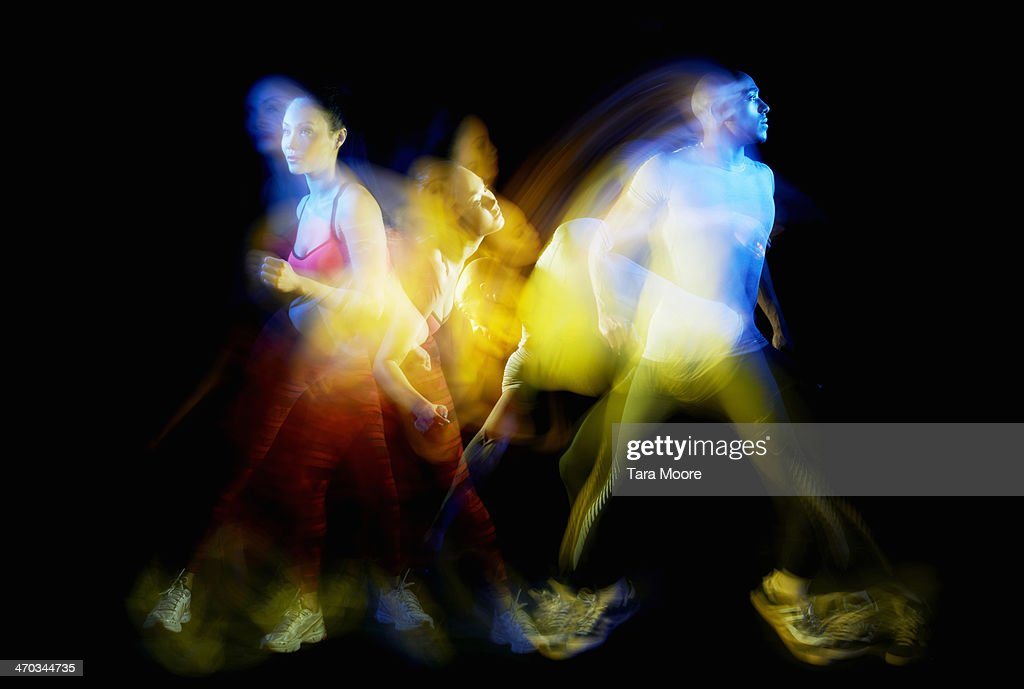 sports man and woman exercising with motion blur : Stock Photo