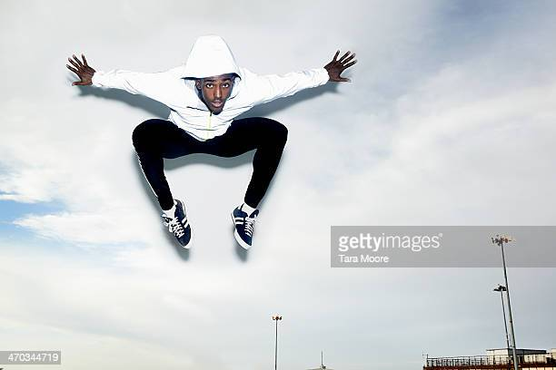 sports man jumping into the sky