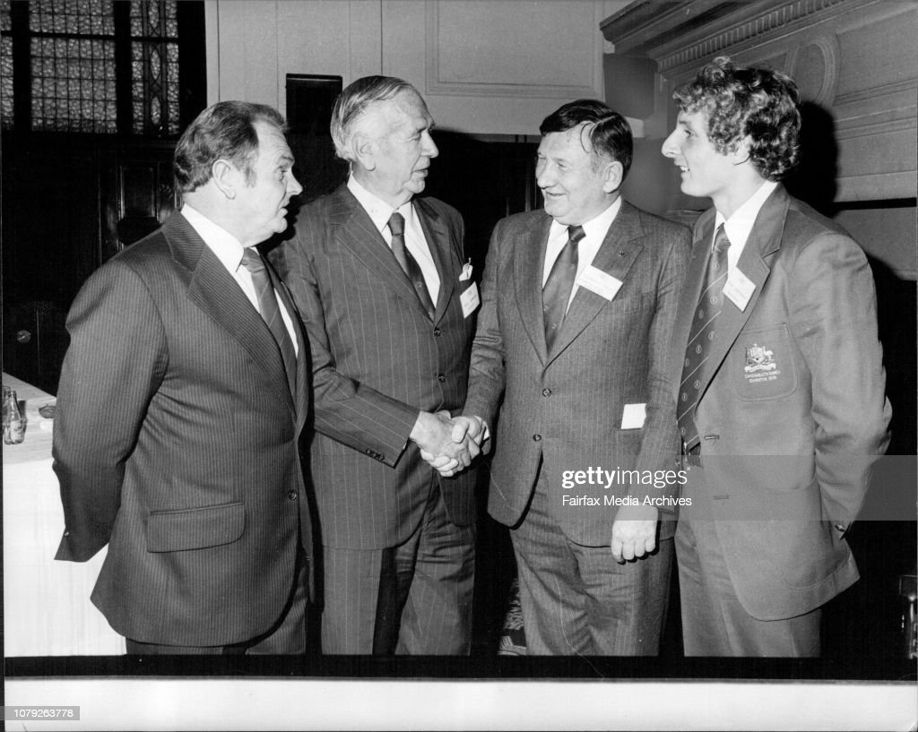 Sports Men's Committee To Raise Money For Games - Mr. Syd Grange (second from left) thanking Norman May for his announcement today of the sportsmen's committee. Mr. Grange is president of the Australian Olympic Federation. Looking on is long distance swim : News Photo