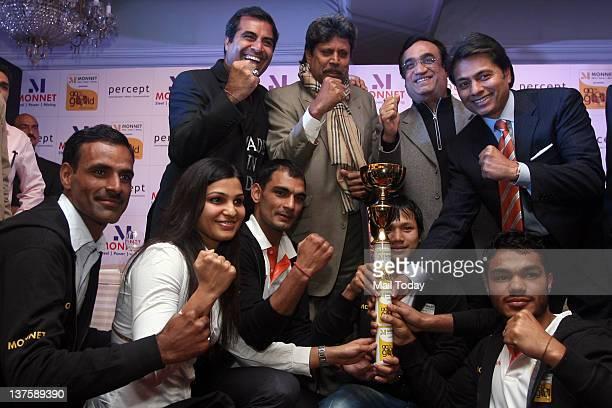 Sports Minister Ajay Maken former Indian cricketer Kapil Dev Vice Chairman MD Monnet Ispat Energy Ltd Sandeep Jajodia and MD Percept Ltd Shailendra...