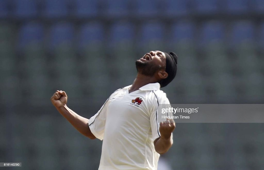 Sports Mumbai player Balwinder Sandhu celebrates thw wicket of Punjab Player during the match between Mumbai and Punjab at Wankhede Stadium in Mumbai.