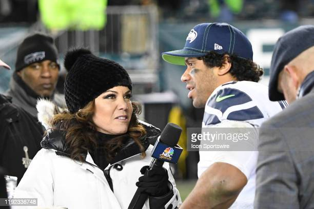 Sports Pam Oliver interviews Seattle Seahawks quarterback Russell Wilson during the Playoff game between the Seattle Seahawks and the Philadelphia...