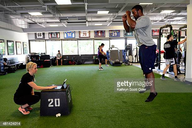 Sports performance coach Whitney Wright performs a knee stability test on Denver Broncos linebacker Chase Vaughn using the ViPerform Sports leagues...