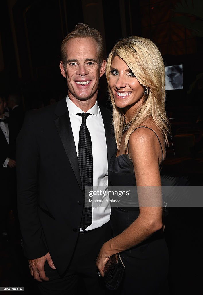 Sports personality Joe Buck (L) and wife Michelle Beisner attend the FOX, 20th Century FOX Television, FX Networks and National Geographic Channel's 2014 Emmy Award Nominee Celebration at Vibiana on August 25, 2014 in Los Angeles, California.
