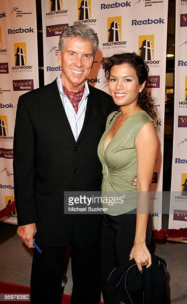 Sports personality Michael Buffer and Christine Prado arrive at the Hollywood Film Festival presentation of Bullets Over Hollywood at the Arclight...