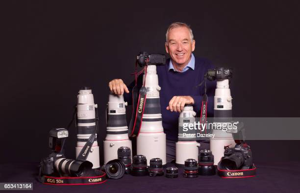 Sports photographer David Cannon poses with camera gear on March 7 2017 in LondonEngland