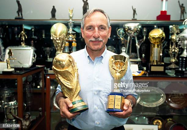 Sports photographer Monte Fresco MBE with the FIFA World Cup and the Jules Rimet trophy at the Brazilian Football Association offices in Rio de...