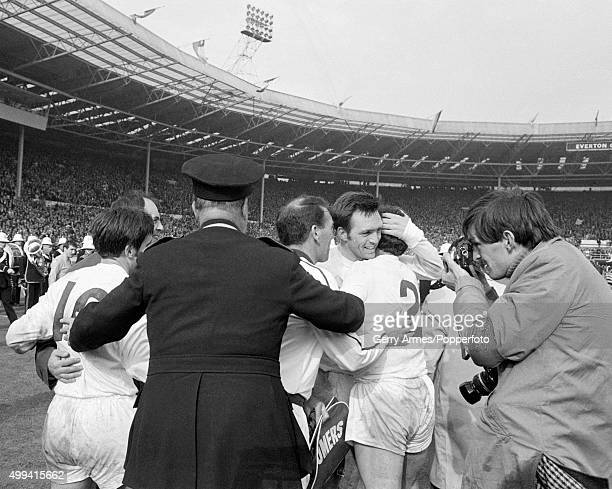 Sports Photographer Peter Robinson gets close to winning goalscorer Jeff Astle on the pitch after the FA Cup Final between West Bromwich Albion and...