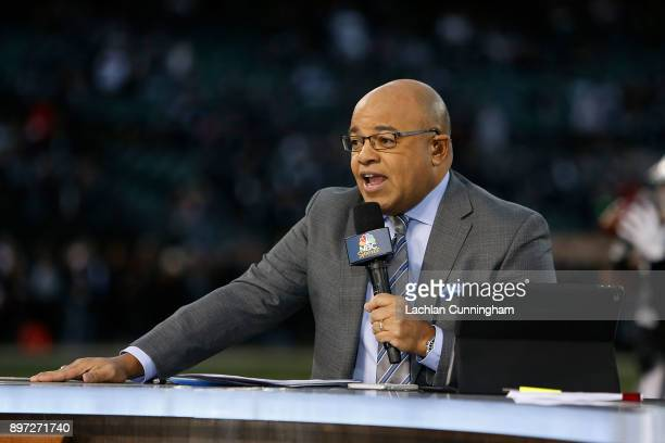 Sports presenter Mike Tirico reports from the sidelines before the game between the Dallas Cowboys and the Oakland Raiders at Oakland-Alameda County...