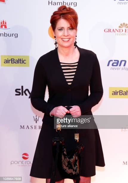 Sports presenter Monica Lierhaus poses on the red carpet at the presentation of the Herbert Award in Hamburg Germany 21 October 2013 The Herbert...