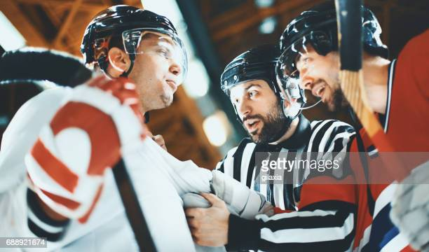 sports referees - hockey player stock pictures, royalty-free photos & images