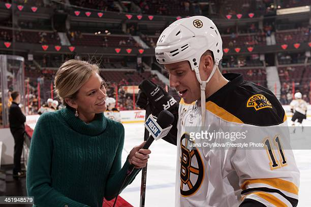 NESN sports reporter Jamie Erdahl interviews Gregory Campbell of of the Boston Bruins during warmups prior to an NHL game against the Ottawa Senators...