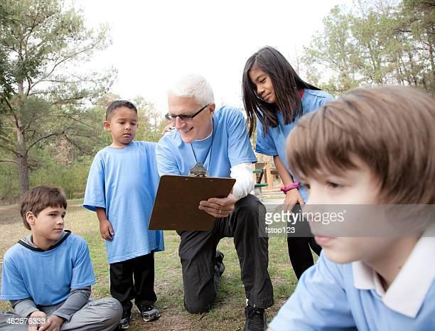 Sports: Senior volunteer coaches underprivileged children.