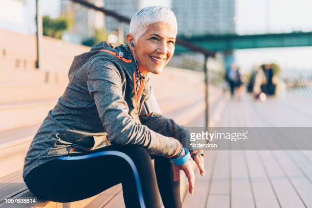 sports senior woman - tranquil scene stock pictures, royalty-free photos & images