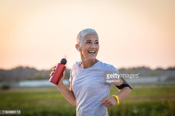 sports senior woman - sporting term stock pictures, royalty-free photos & images