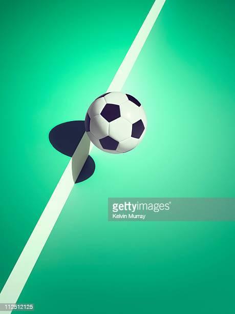 sports shadow - ballon de football photos et images de collection
